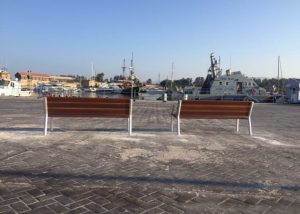 Banks and wastebaskets in the port of Paphos, Cyprus - 2020