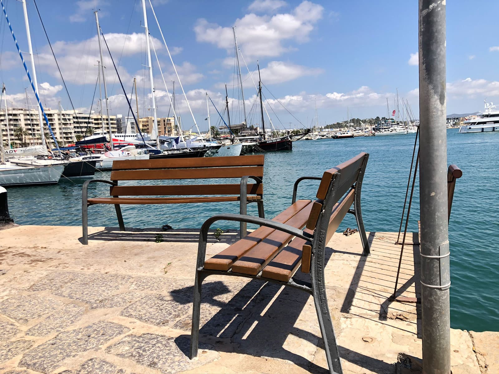 Wooden benches in the port of Ibiza - 2021
